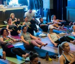 Strengthen your core with boat pose during a yoga class at Duality Fit in Sloan Lake.