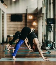 Practice your downward-facing dog and learn the basics of yoga at Duality Fit in Sloan Lake.