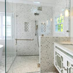 Frameless glass shower doors with unique shower door handles.