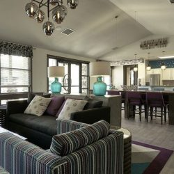 Apartment clubhouse with living room and kitchen - Elements at Prairie Center