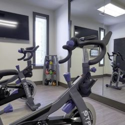 Two stationary bikes at an apartment fitness center - Elements at Prairie Center