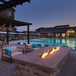 Outdoor area with pool, firepit, and lounge area - Elements at Prairie Center