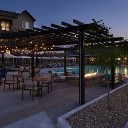 Apartment complex outdoor area with pergola, lounge area, and pool - Elements at Prairie Center