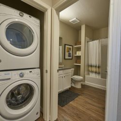 Stacking washer and dryer off of a bathroom in an apartment - Elements at Prairie Center