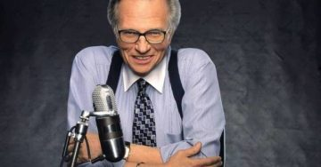Image of Larry King and a microphone in a studio.