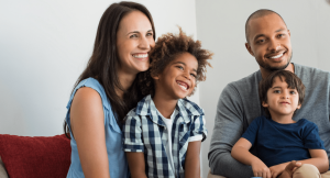 A woman, man, and two children in a blended family.