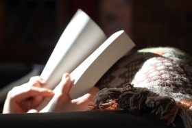 An image of a person reading a book.