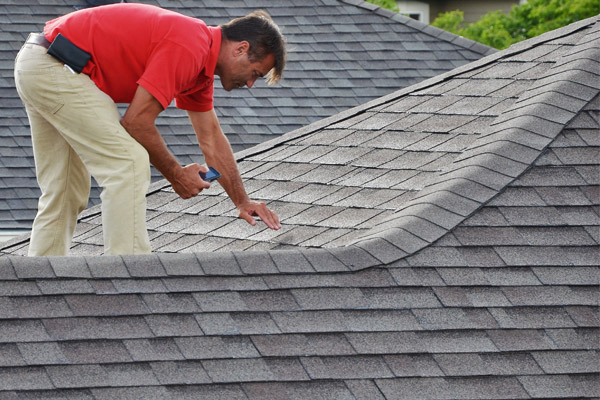 Man inspecting the roof