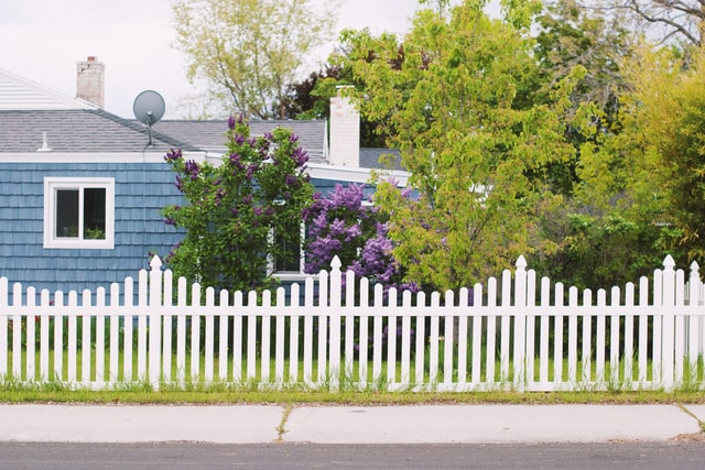 White Fence by the blue house