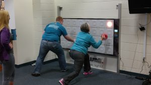Two YMCA members testing out the T-Wall 32.