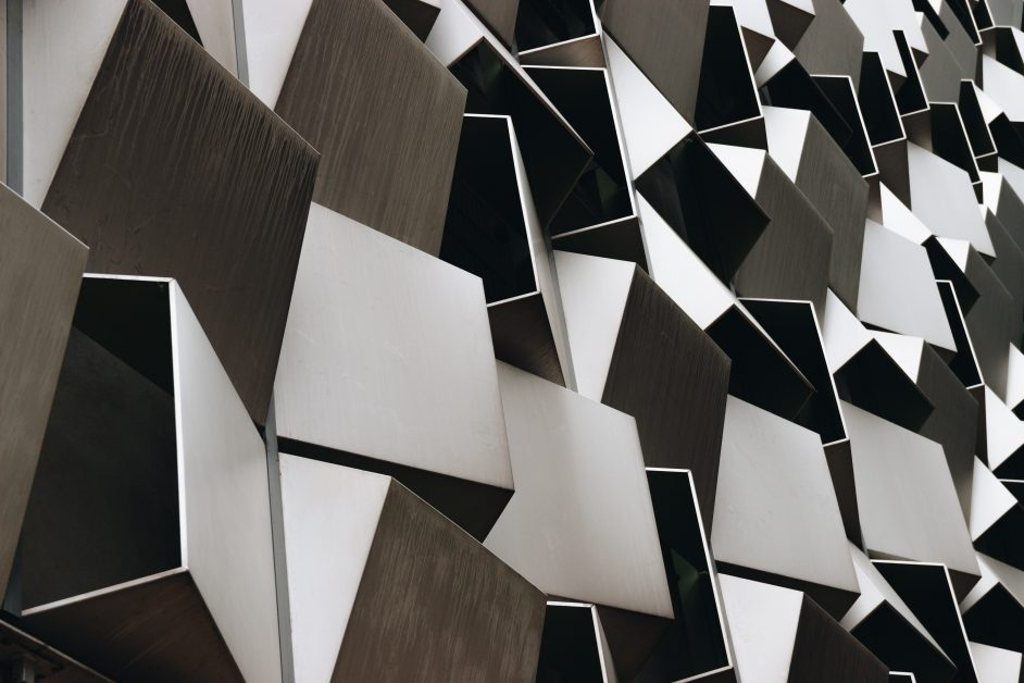Brown, black, and grey metallic wall decor in geometric squares. Photo by Callum Wale on Unsplash.