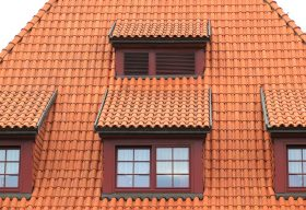 A picture of a burnt sienna clay tile roof. Photo courtesy of olafpictures from pixabay.com, reused with permission by Express Roofing.