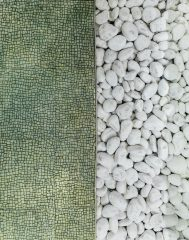 Aerial photo of white pebbles and a green tile mosaic. Photo by John Mark Arnold on Unsplash