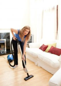 unhappy-woman-with-vaccum-cleaner