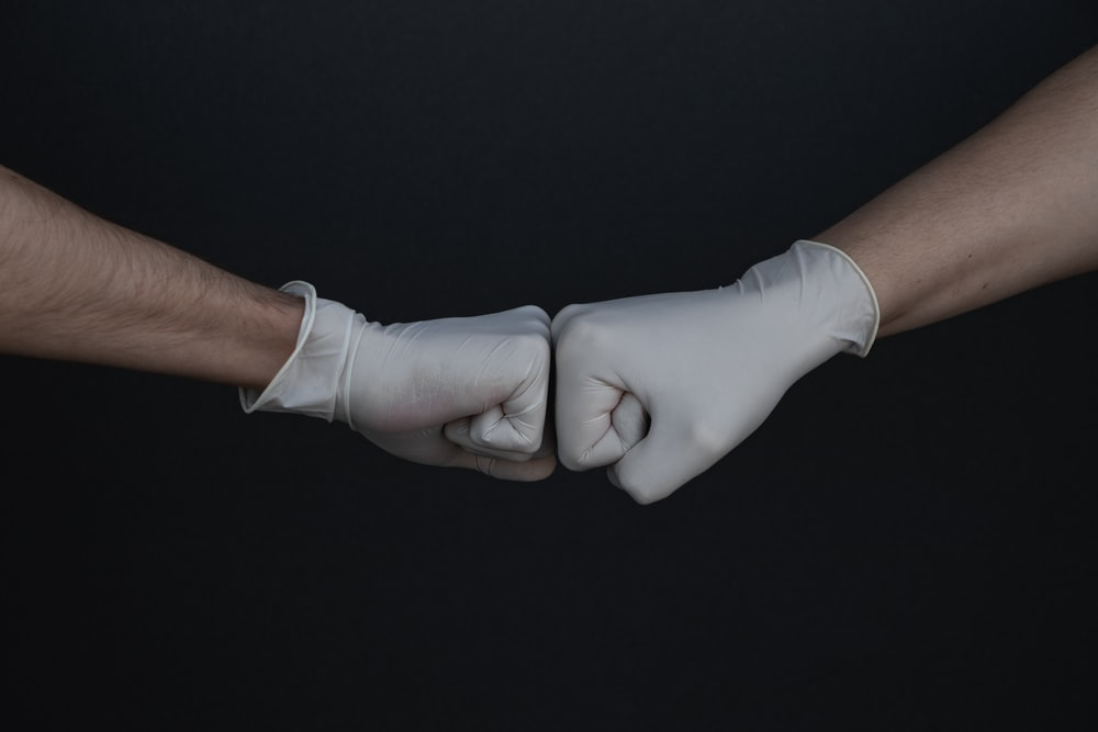two healthcare workers fist bump