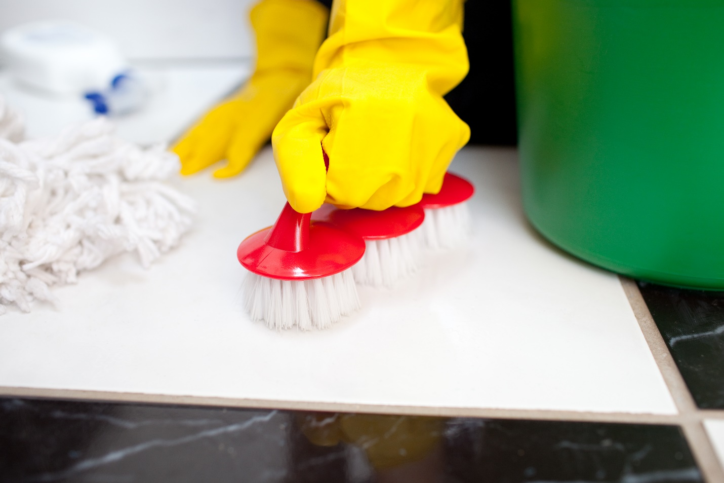 Janitorial cleaning and scrubbing with a brush