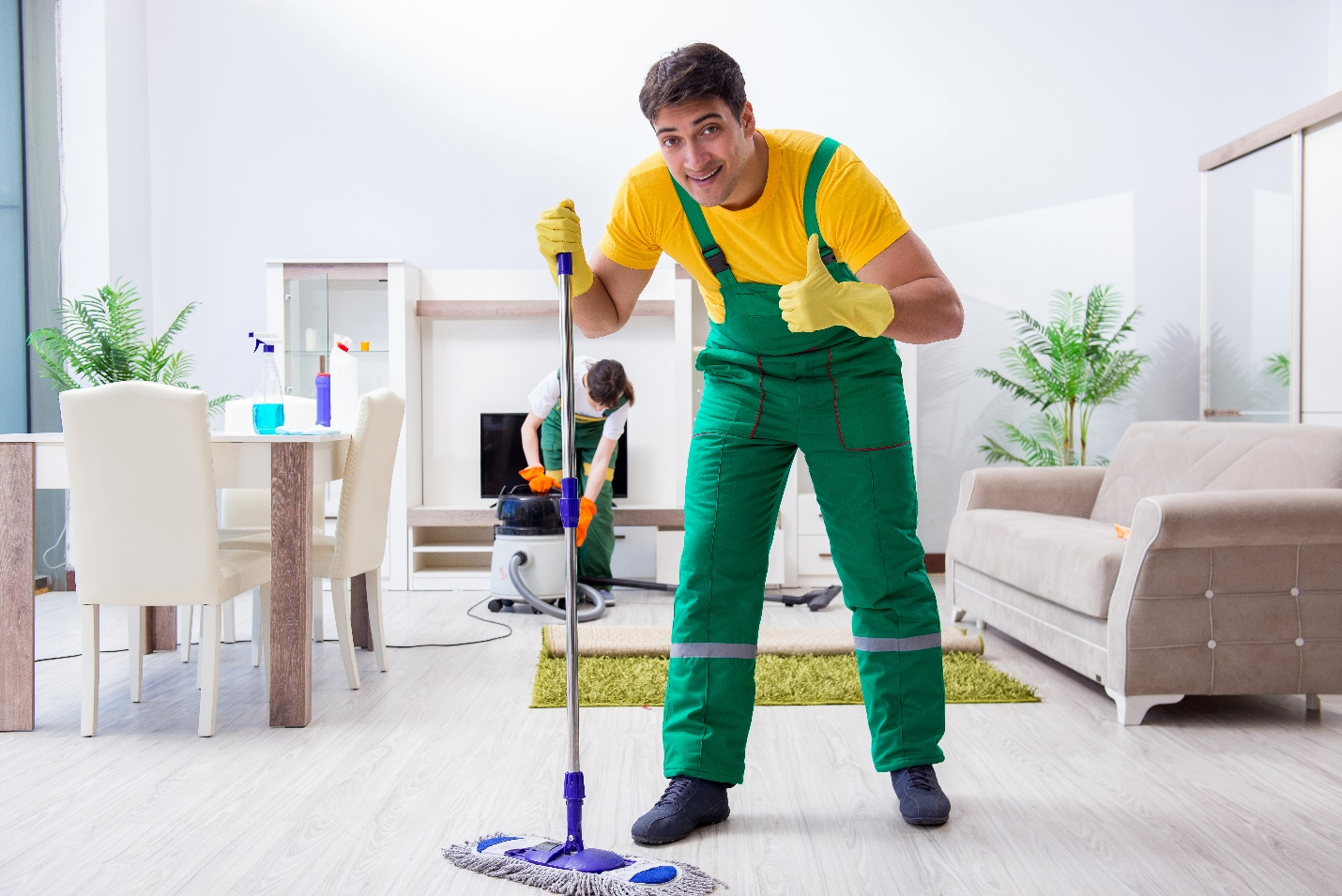 Man and woman from commercial cleaning services