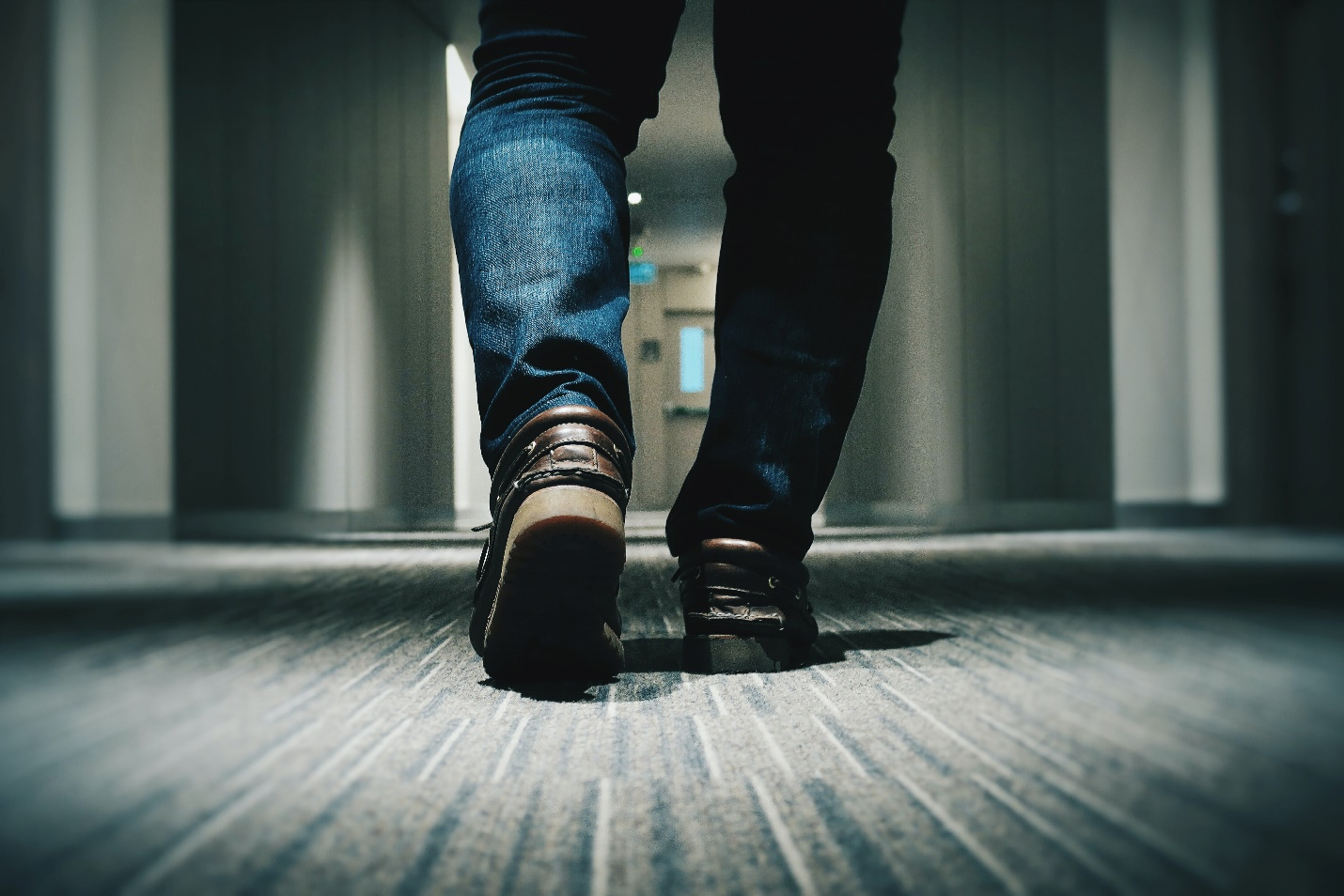 Person walking on a patterned carpet