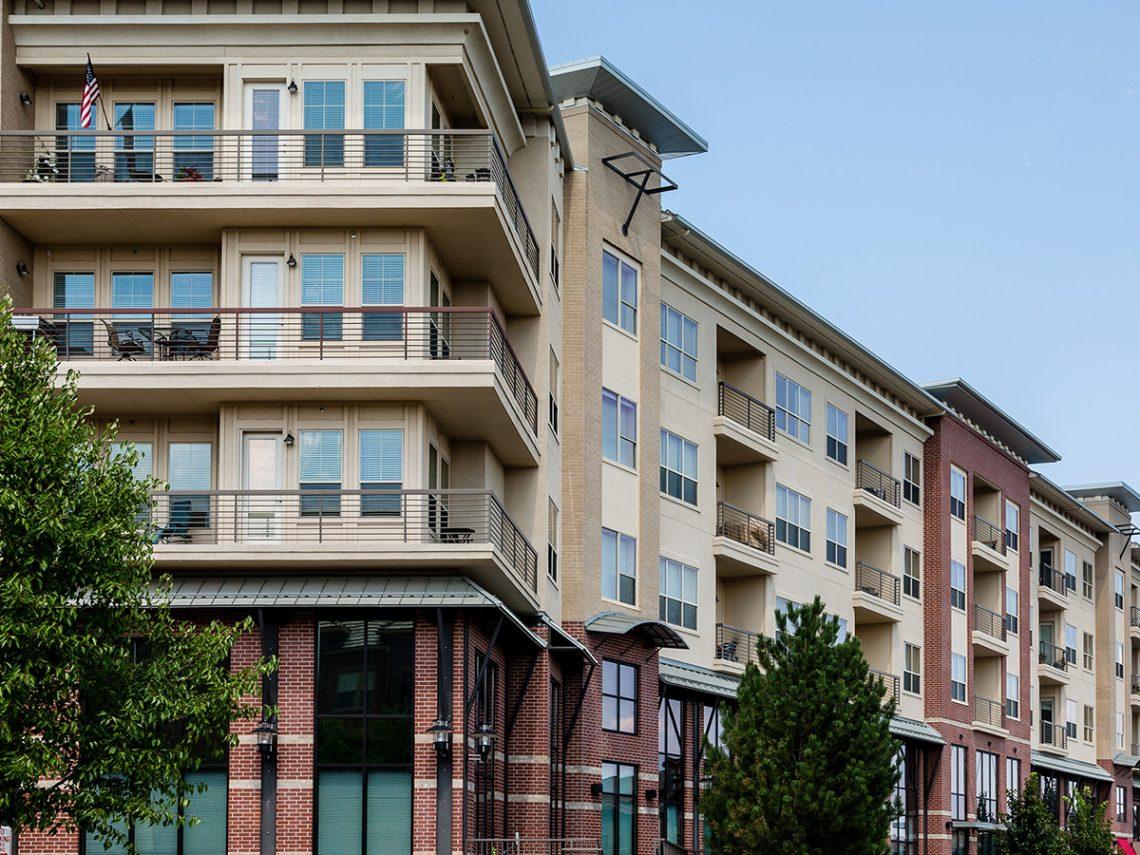Modern brick and stucco condo buildings.