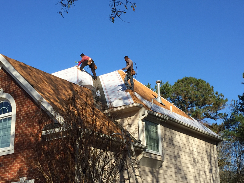 Roofing contractors installing a new roof.