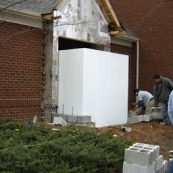 Installing an above ground storm shelter in an existing home