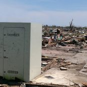 Grey storm shelter in the aftermath of a massive tornado