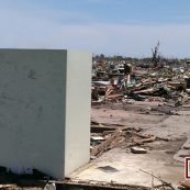 A FamilySAFE storm shelter standing after a massive natural disaster