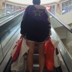 A dance student riding an escalator