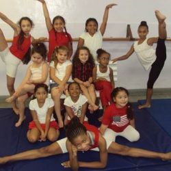Students smiling in a gymnastics class