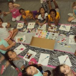 Dance students smiling and drawing pictures