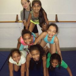 Young girls in a gymnastics class