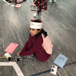 Girl in pajamas and paper hat sitting on floor - Fancy Feet Dance