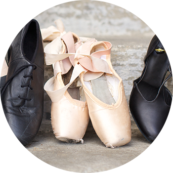 Jazz, tap, and ballet shoes lined up outside