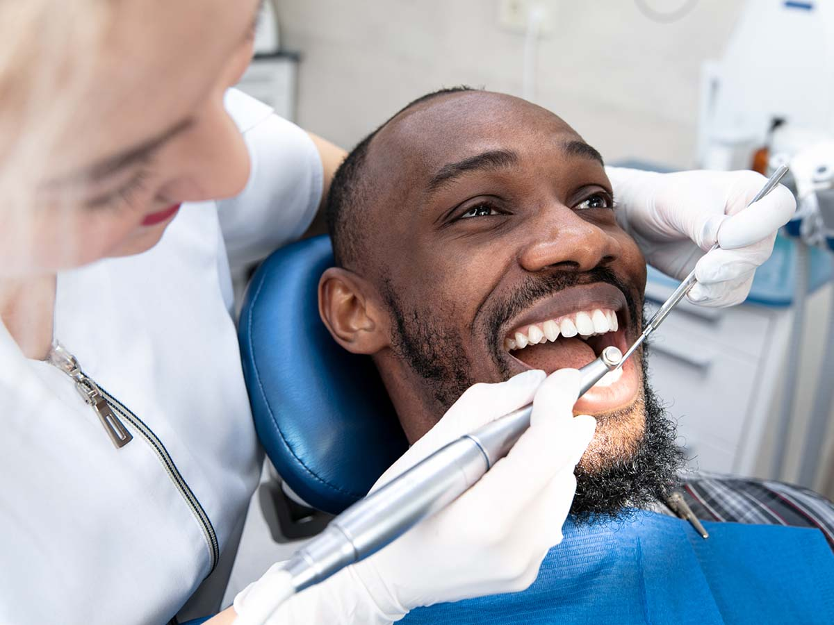 young man getting his teeth cleaned