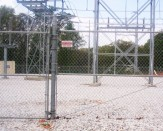 commercial chain link fence around electric wires