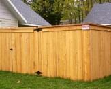 cap and trim wood fencing