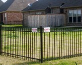 residential steel fencing around home