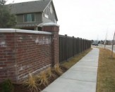 trex composite fence and brick wall