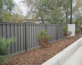 commercial trex composite fence near curb