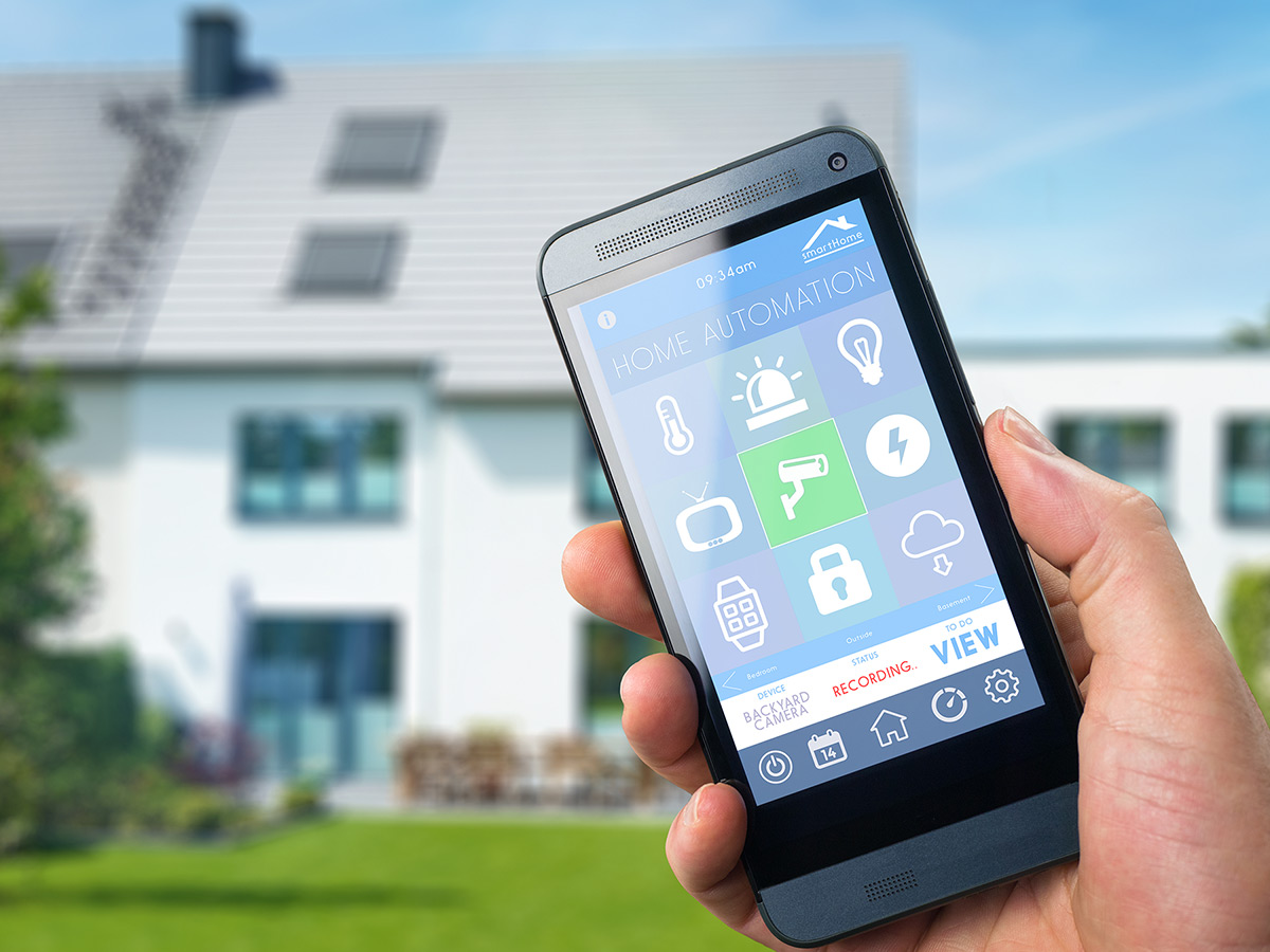 Home automation control on a smartphone held in hand.