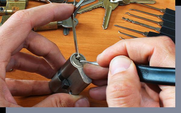 Image of a locksmith repairing a door lock.