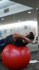 An image of a person using an exercise ball.