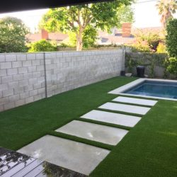 Artificial Grass Surrounding Residential Pool - Five Star Turf Commercial