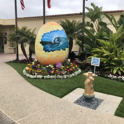Turf Installation Around Egg Sculpture - Five Star Turf Commercial