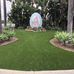 Turf Installation Surrounding Egg Sculpture - Five Star Turf Commercial