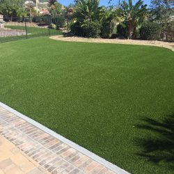 Artificial Grass Installation Next to a Home - Five Star Turf Commercial