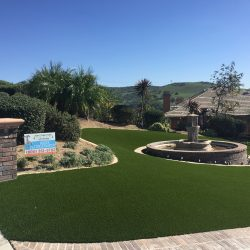 Completed Turf Installation Around Fountain - Five Star Turf Commercial