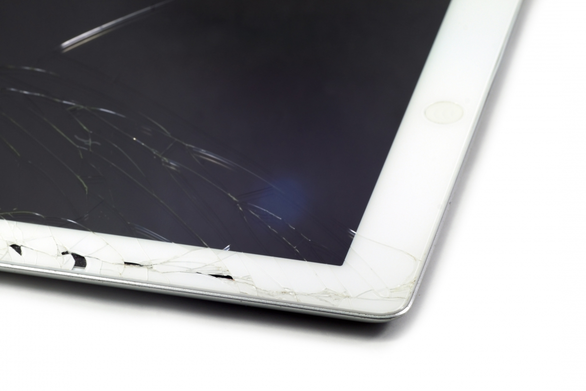 An iPad with a cracked screen.