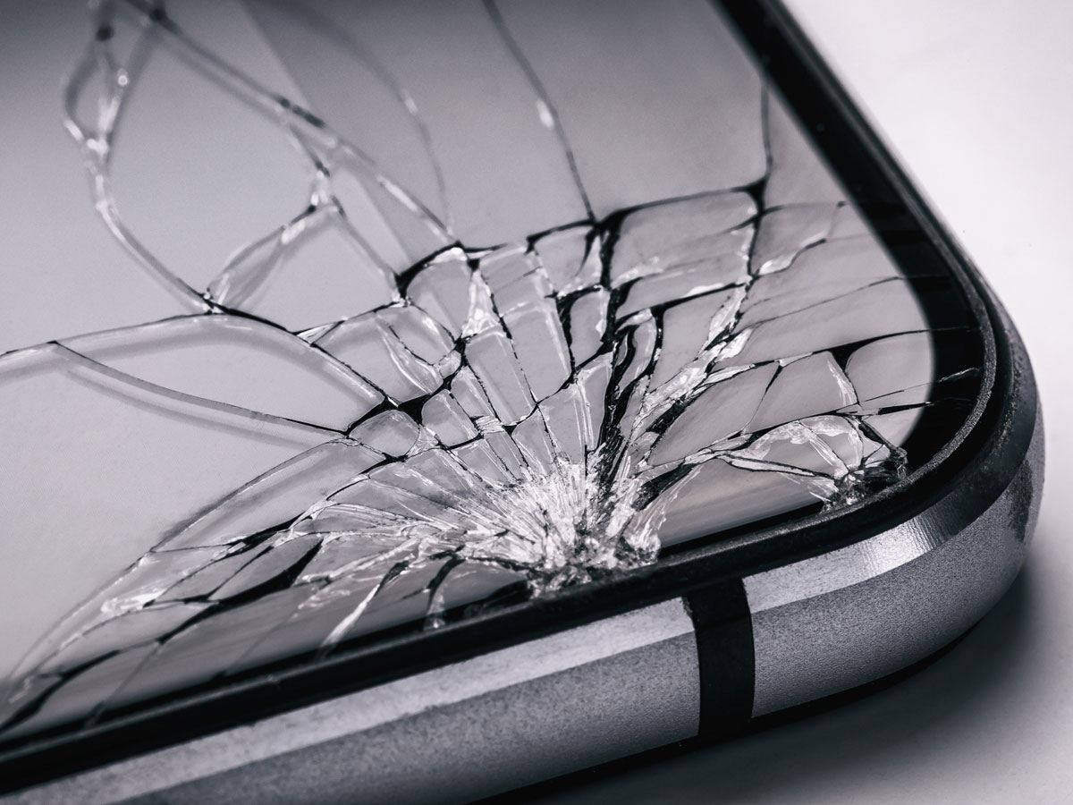 Image of a cell phone with a cracked screen