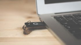 An image of a flashdrive in the USB port of a laptop